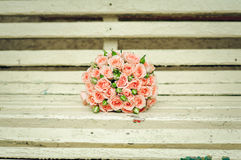 Beautiful bouquet of roses lie on a bench Stock Images