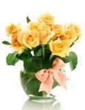 Beautiful bouquet of roses in transparent vase Stock Photos