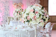 Beautiful bouquet of roses in wedding decor restaurant. Interior stock photography