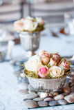 Beautiful bouquet of roses at wedding reception Stock Image