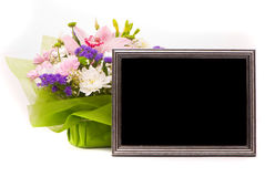 Beautiful bouquet and silver frame Stock Image