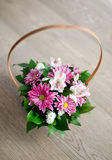 Beautiful bouquet of spring flowers in basket isolated on parque Stock Image