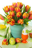 Beautiful bouquet of tulips with easter eggs. stock photo