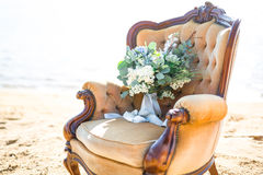 Beautiful bouquet for wedding ceremony in a chair on the shore of a sea Royalty Free Stock Photos