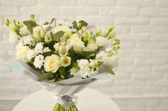 Beautiful bouquet with white roses and camomiles stock photography