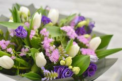 Beautiful bouquet with white tulips and eustomy stock photo