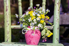 Beautiful bouquet with wild  flowers in pink vase with ribbon Royalty Free Stock Image