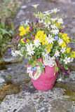 Beautiful bouquet with wild  flowers in pink vase with ribbon Royalty Free Stock Photo