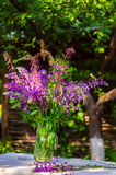 Beautiful bouquet of wild flowers of purple and pink. Bouquet of Royalty Free Stock Image