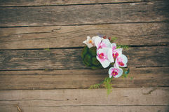 Beautiful bouquet on wooden background. Beautiful bouquet lying on the wooden pier Royalty Free Stock Photography