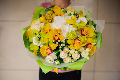 Beautiful bouquet of yellow flowers in hands the girl royalty free stock photos