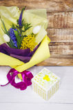 Beautiful bouquet in yellow and purple packaging Stock Photo
