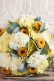 Beautiful bouquet of yellow and white carnations royalty free stock image