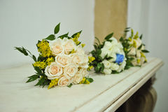 Beautiful bouquets of bright flowers, on table Royalty Free Stock Image