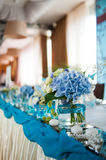 Beautiful bouquets decoration on wedding table in a restaurant Stock Photos