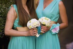 Beautiful bouquets of flowers ready for the big wedding ceremony. Groom with bride. Hugs Stock Photography