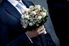 Beautiful bouquets of flowers ready for the big wedding ceremony. Groom with bride. Hugs Royalty Free Stock Photo