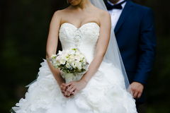 Beautiful bouquets of flowers ready for the big wedding ceremony. Groom with bride. Hugs Stock Photo