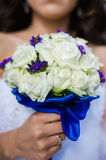 Beautiful bouquets of flowers ready for the big wedding ceremony. Groom with bride. Hugs Stock Images