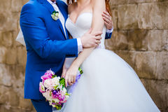 Beautiful bouquets of flowers ready for the big wedding ceremony. Groom with bride. Hugs Stock Photos