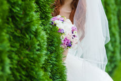Beautiful bouquets of flowers ready for the big wedding ceremony. Groom with bride. Hugs Royalty Free Stock Photography