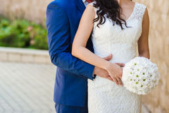 Beautiful bouquets of flowers ready for the big wedding ceremony. Groom with bride. Hugs Stock Image