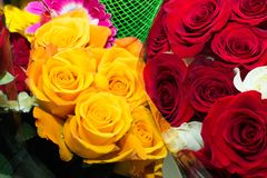 Beautiful bouquets of roses, red and yellow flowers royalty free stock images