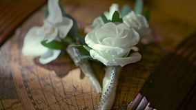 Beautiful Boutonniere Made From the White Rose. Lying on the globe in the library stock video footage