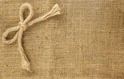 Beautiful bow on brown hemp background Stock Image