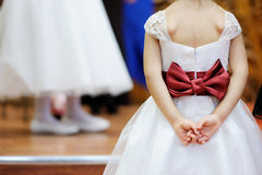 Beautiful bow on flower-girl's dress Royalty Free Stock Photos