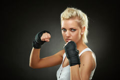 Beautiful boxer girl with black bandage on hands Royalty Free Stock Images