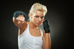 Beautiful boxer girl with black bandage on hands Stock Photo