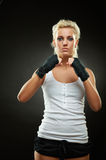 Beautiful boxer girl with black bandage on hands Royalty Free Stock Photo