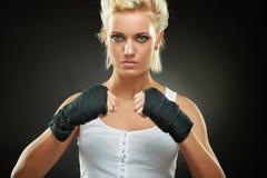 Beautiful boxer girl with black bandage on hands Stock Photo