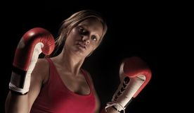 Beautiful boxer girl over black background Royalty Free Stock Images