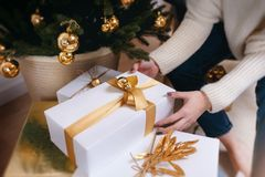 Beautiful boxes with different presents that are being prepared for the christmas night or new year party Royalty Free Stock Photography