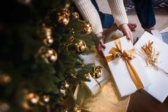 Beautiful boxes with different presents that are being prepared for the christmas night or new year party Royalty Free Stock Image