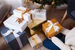 Beautiful boxes with different presents that are being prepared for the christmas night or new year party Stock Image