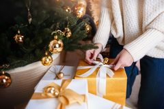 Beautiful boxes with different presents that are being prepared for the christmas night or new year party Stock Photos