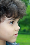 Beautiful boy. Close portrait of a beautiful boy with curly hair, profile Royalty Free Stock Photo