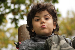 Beautiful boy. Outdoor portrait of an attractive boy with cute expression Stock Photos