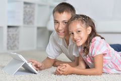Beautiful Boy And Girl With Tablet Pc Royalty Free Stock Photo