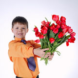 Beautiful boy with big bouquet of tulips Royalty Free Stock Image