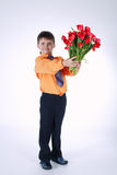 Beautiful boy with big bouquet of tulips Royalty Free Stock Photography