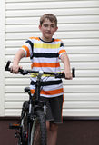 Beautiful boy with a bike Stock Images