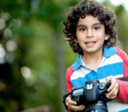 Beautiful boy with a camera Royalty Free Stock Photos
