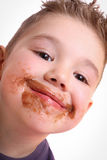 Beautiful boy with chocolate stained Stock Image