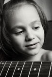 Beautiful Boy closeup. Portrait of a little boy with a guitar Royalty Free Stock Photos