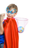 Beautiful boy dressed as superman saving the Earth. Beautiful funny child wearing funny glasses dressed as superhero saving the Earth Royalty Free Stock Photography