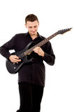 A beautiful boy with electric guitar plays Stock Images